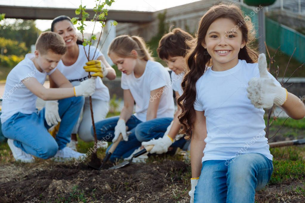 pupils planting young tree