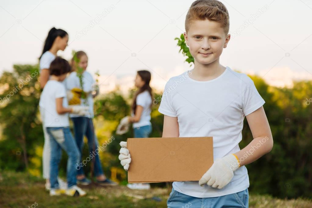Handsome kid demonstrating carton plate