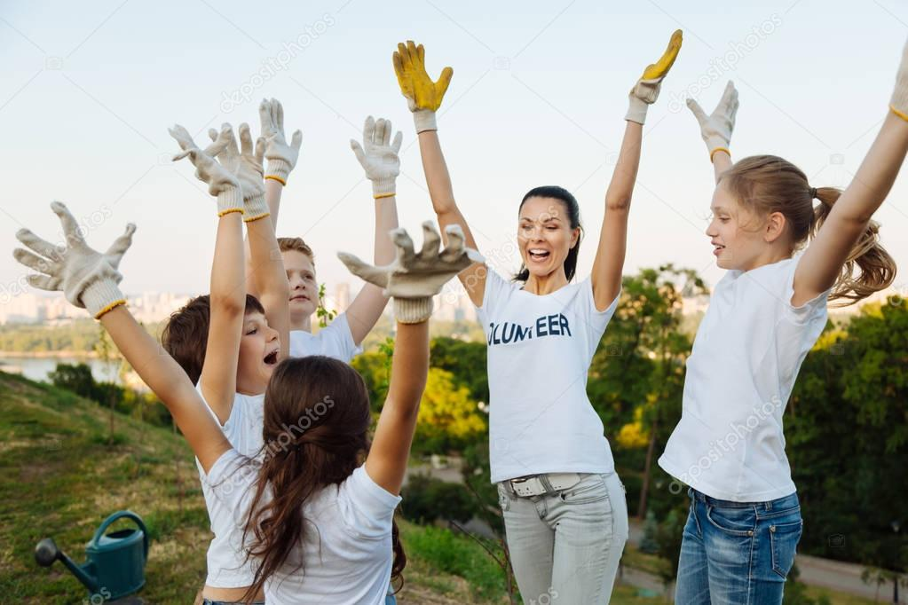 tutor near her team while raising arms