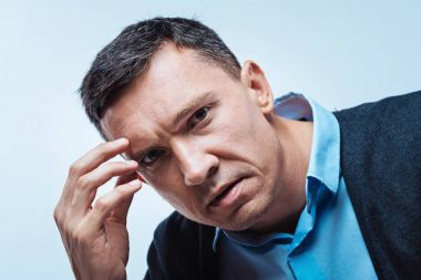 Close up portrait of frustrated mature man
