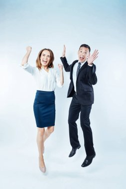 Emotional colleagues getting excited together over background
