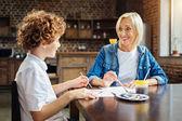 Fotografie Slightly surprised granny listening to her grandson story