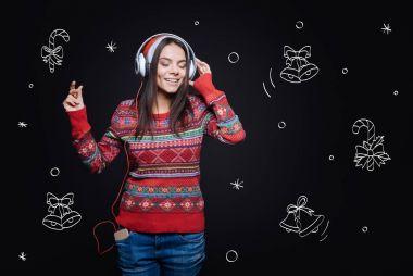 Involved delighted girl enjoying Christmas songs