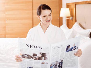 Fabulous pretty woman  reading news