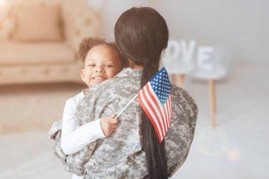 Cheerful positive girl holding an American flag