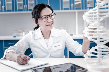 Enthusiastic female scientist conducting genetic research