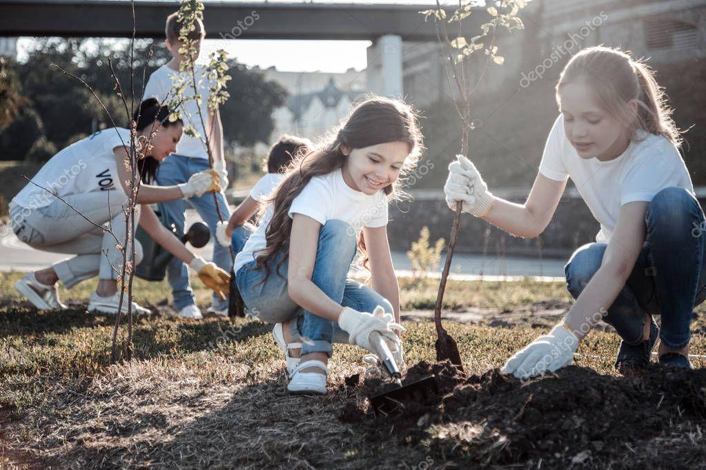 Cute pretty girls planting trees