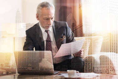 Serious entrepreneur reading business document