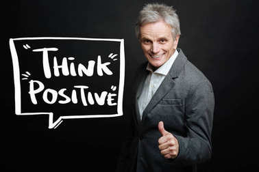 Aged man smiling and encouraging to positive thinking