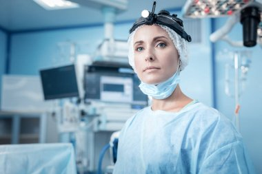 Nice young woman standing in the operation theater