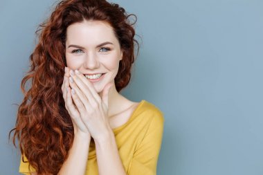 Portrait of a delighted young woman