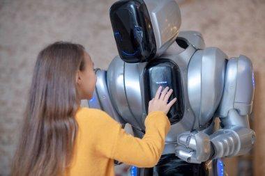 Long-haired girl setting program for house robot