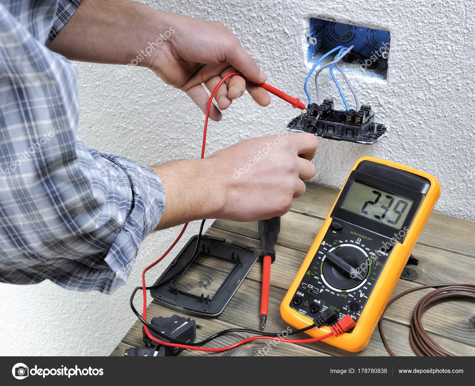 Young Electrician Working In A Residential Electrical Installati Stock Photo