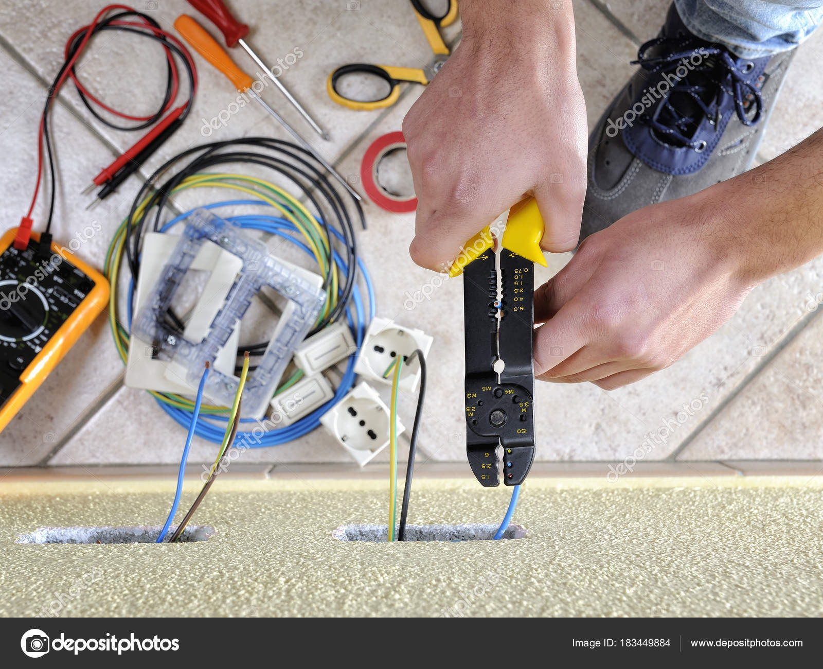 Electrician technician at work on a residential electric system ...