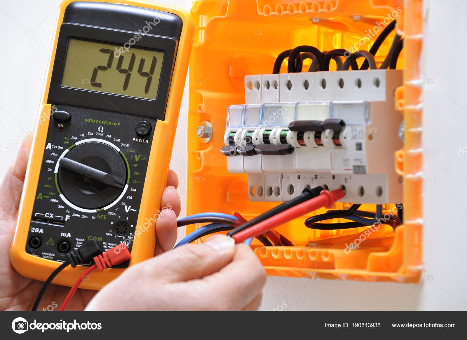 Electrician technician at work on a residential electric panel ...