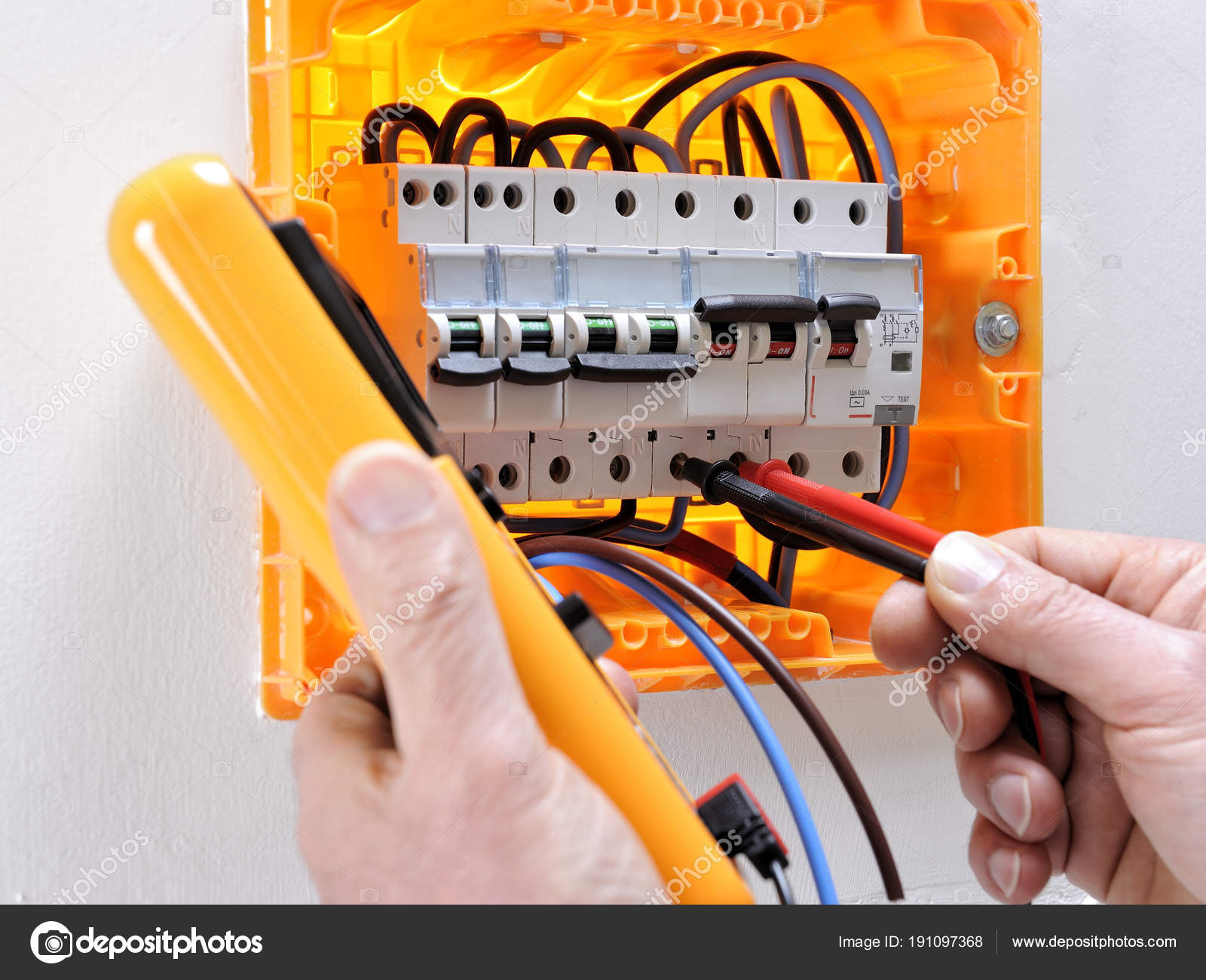 Electrician Technician At Work On A Residential Electric Panel How Circuit Breaker Works Working Electrical Measures The Voltage Terminals Of Thermal Magnetic Photo By