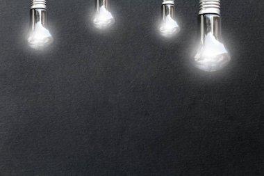 Light bulbs on black