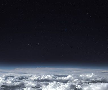 Planet Earth with stars and clouds