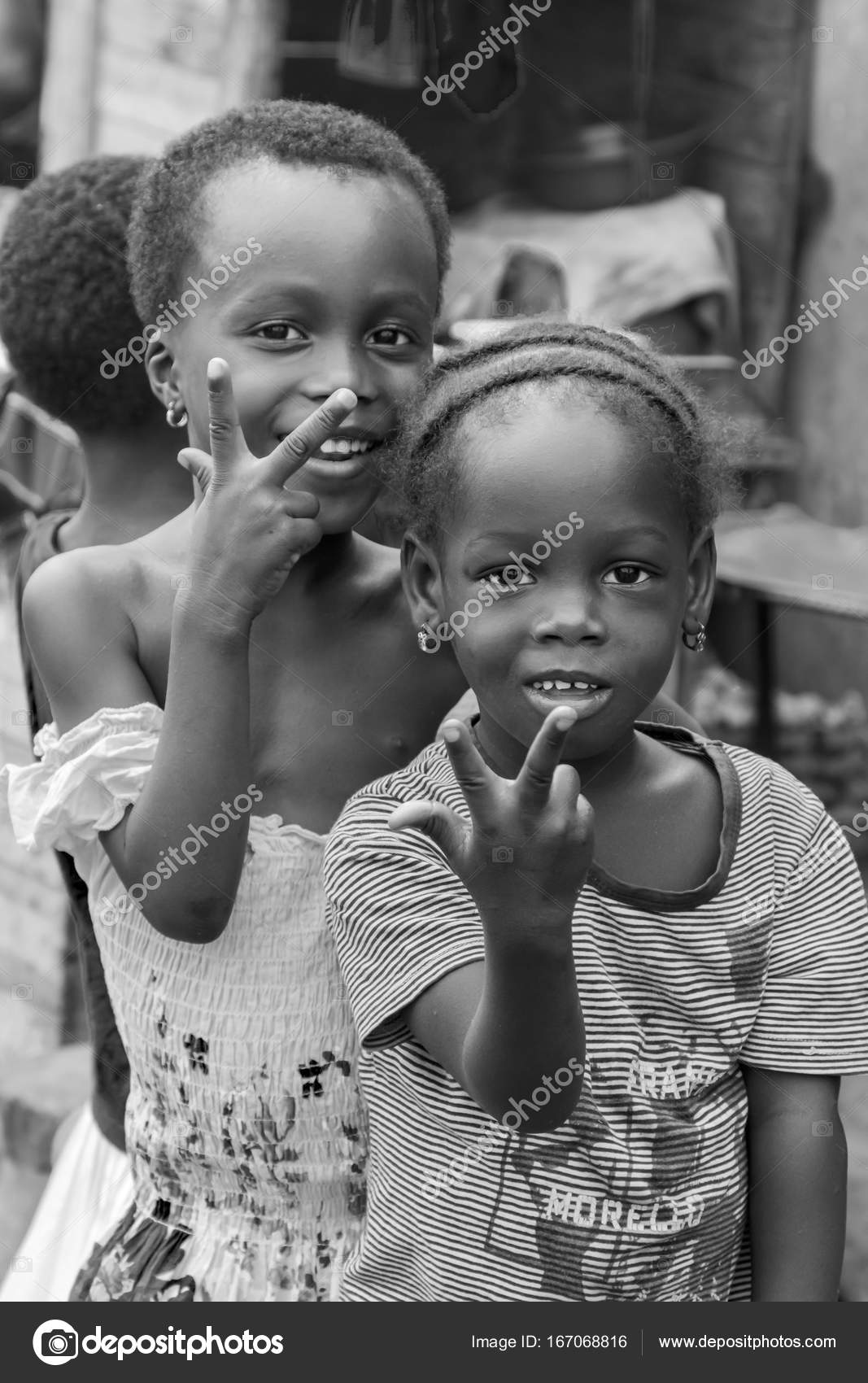 Accra ghana december 28 2016 happy children in a street in accra ghana photo by tizianella