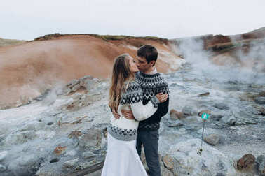 Lovely couple kissing on mountains background
