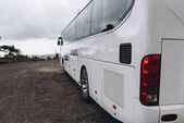 Fotografie view of white bus back with rainy clouds in sky
