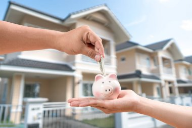 Saving to buy a house or home concept savings.