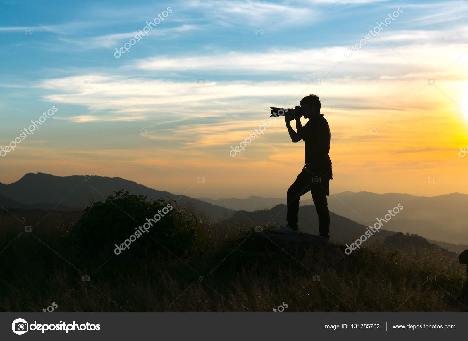 Nature photographer taking photos in the mountains — Stock