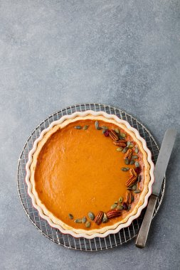 Pumpkin pie, tart in a baking dish. Top view