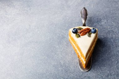 Vegan carrot cake. Healthy food. Grey stone background. Copy space. Top view.