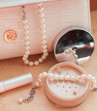 Mineral loose powder and powder brush. Women's cosmetics. Decorative cosmetics in retro style.