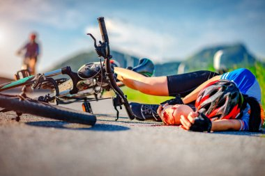 accident clashed on young woman bicyclist in hurt and injured at knee of leg and arms, after accident clashed, with mortal wound and bleeding of blood flow on the surface of street roa