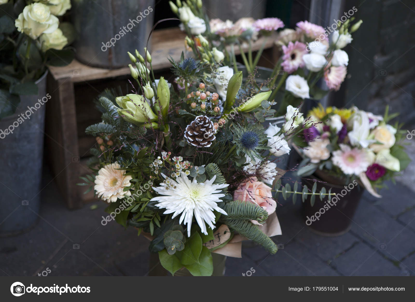 The bouquet of flowers from chrysanthemums red berries and cones on bouquet of flowers from chrysanthemums red berries and cones on a flower market for sale photo by elenarostunova izmirmasajfo