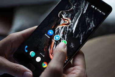 smartphone with icons of social media on screen
