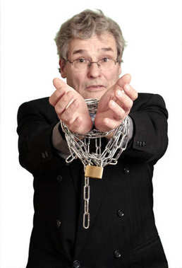 Businessman with his hands tight with a lock and chain: Being trapped by regulations concept. Isolated on White Cut-Out