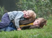 Fotografie Two cute Siblings Brothers having fun Together outside in Nature
