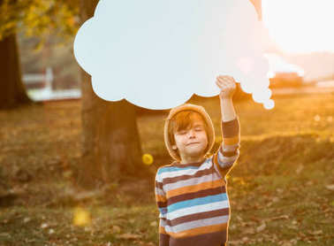 Little Boy expressing himself by using speech bubbles: being calm and relaxed, only thinking good thoughts