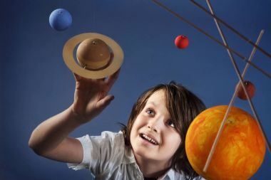 Kids and Science, self made Solar System Project - Studio shots with Young happy Boy stock vector