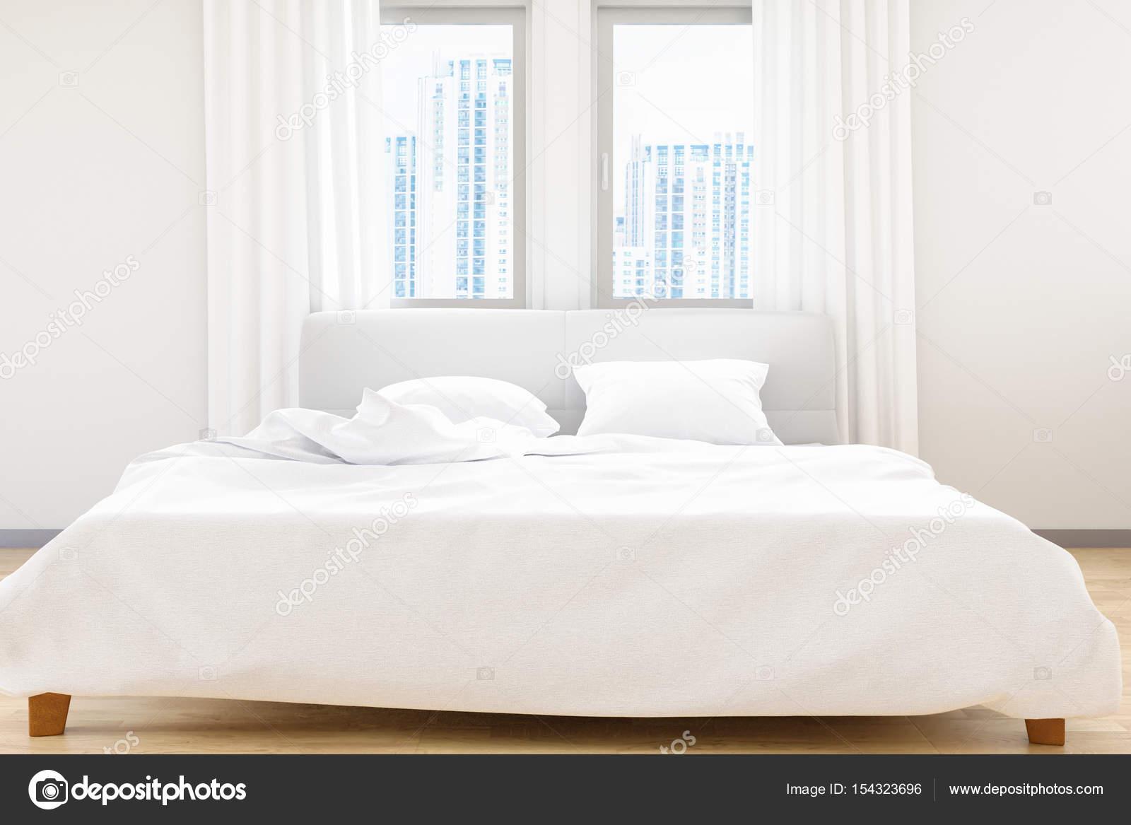 De moderne witte slaapkamer bed lakens en kussens comfort en