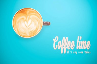coffee latte art on the blue color background ,soft vintage tone