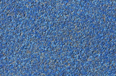abstract blue background paving consisting of small pebbles embedded in cement exterior floor or road design