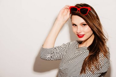 High fashion look.glamor stylish beautiful young happy smiling woman model with red lips and red sunglasses