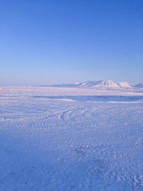 bright winter landscape field mountains sky