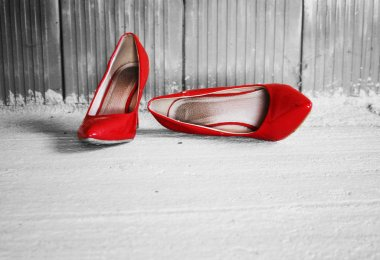 red heels shoes in an unfinished house