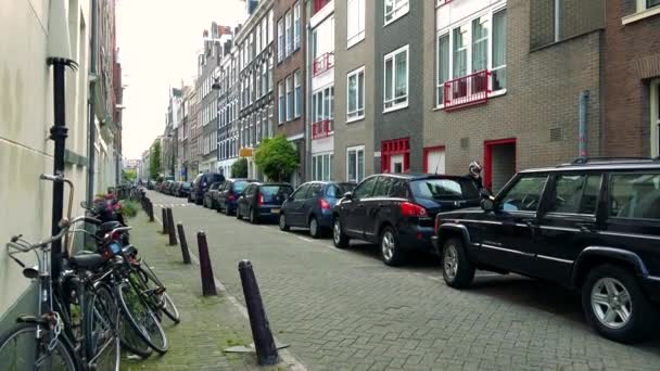 Cars parked in empty street