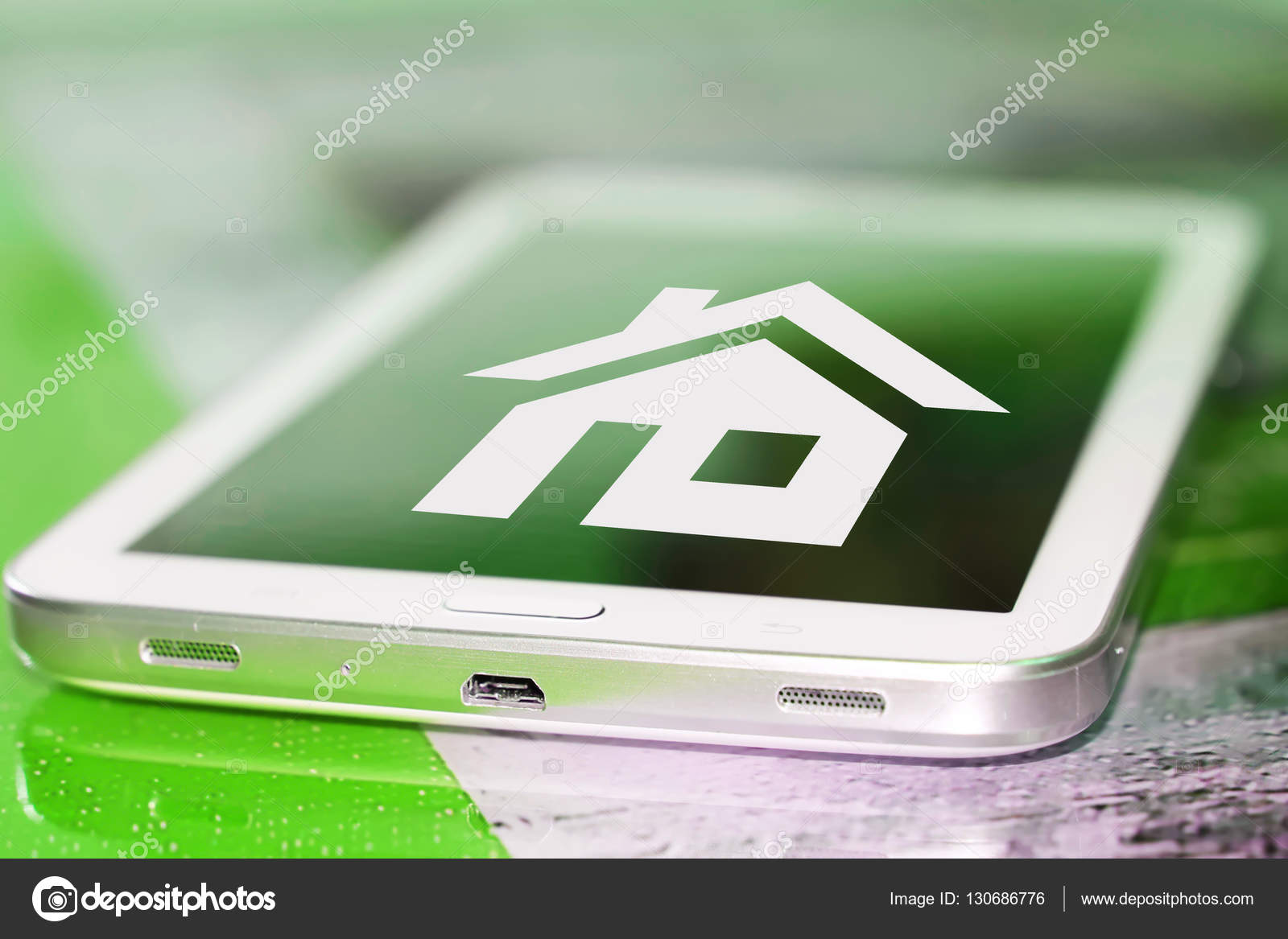 A House Symbol On The Cell Phone Screen Stock Photo Vlerijse