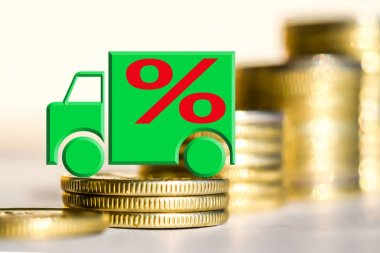 Car and red percent sign on a background of money .