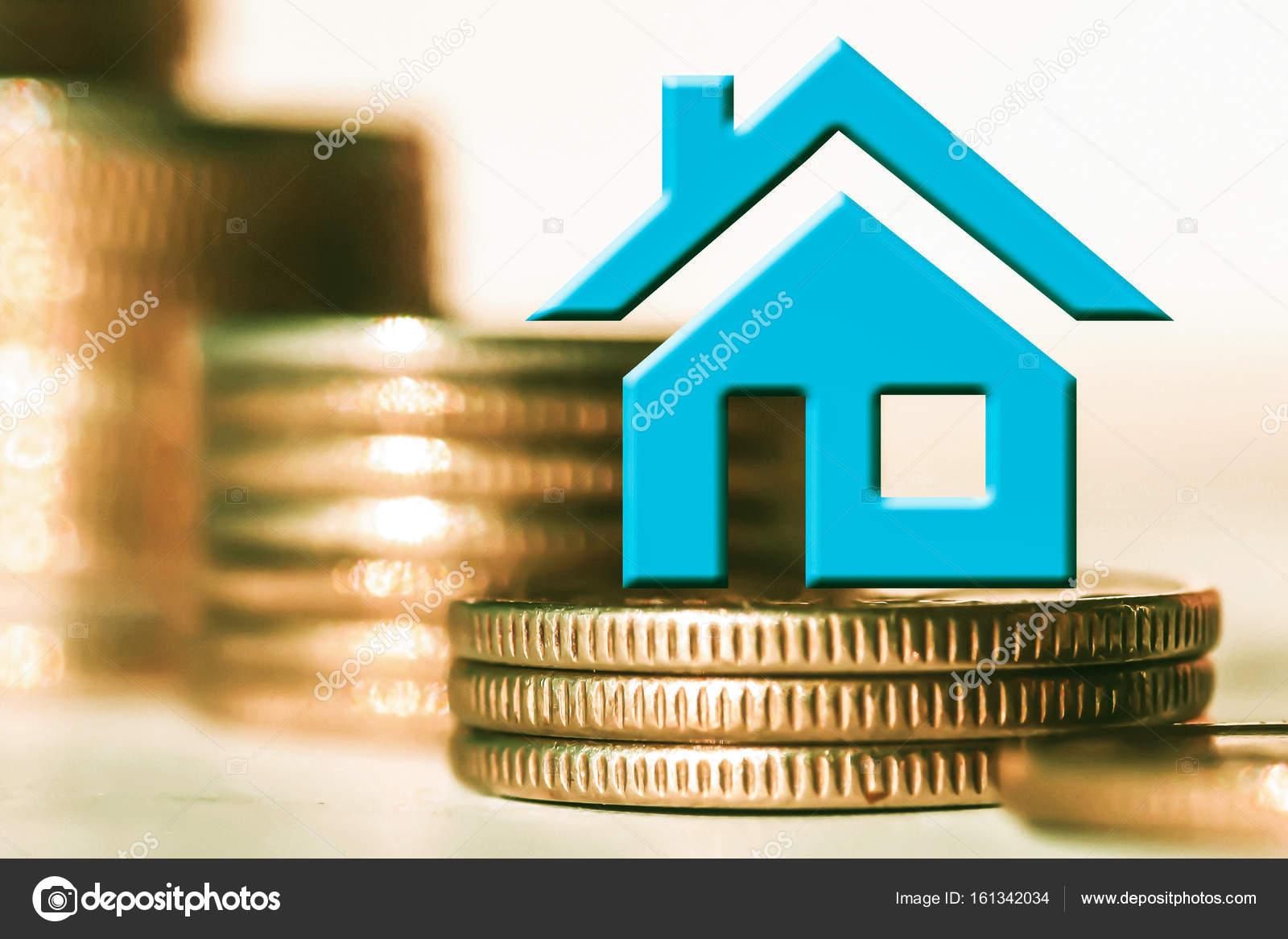 Lu0027immobile In Simbolo Su Un Fondo Di Denaro. Il Concetto Delle Variazioni  Dei Prezzi Sul Mercato Immobiliare U2014 Foto Di Vlerijse
