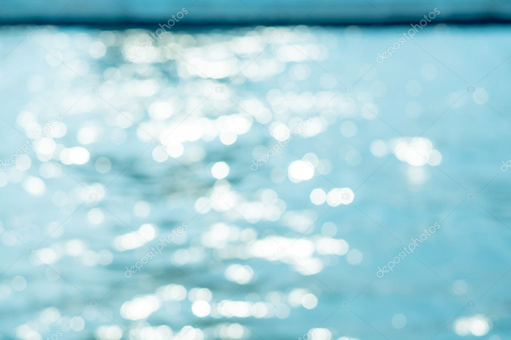Blurred background of ripple water with bokeh light,Vintage filt