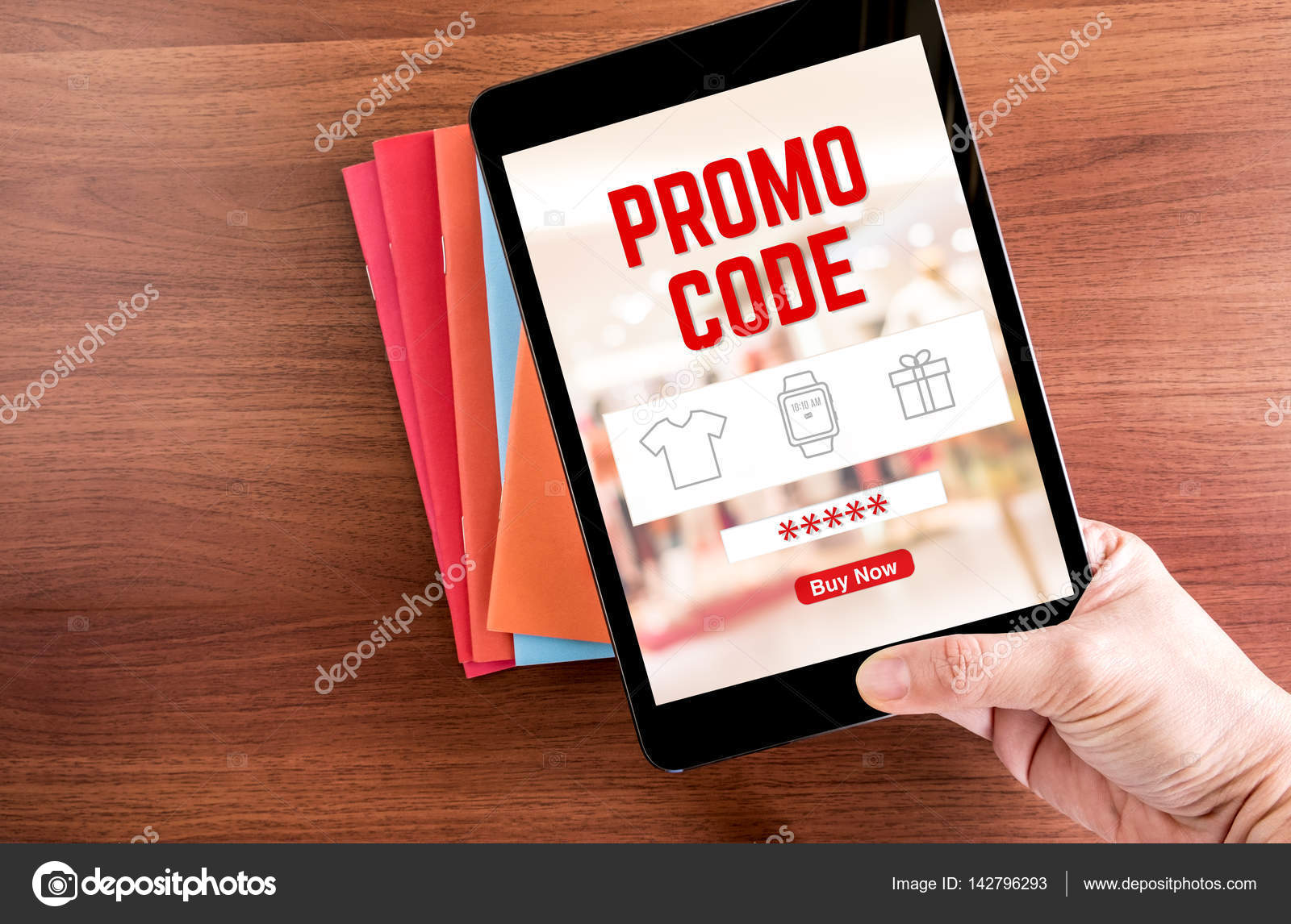 Top View Of Hand Holding Tablet With Promo Code Word Blur Store Background Over Color Notebook On Wooden Table TopOnline Shopping Business Concept