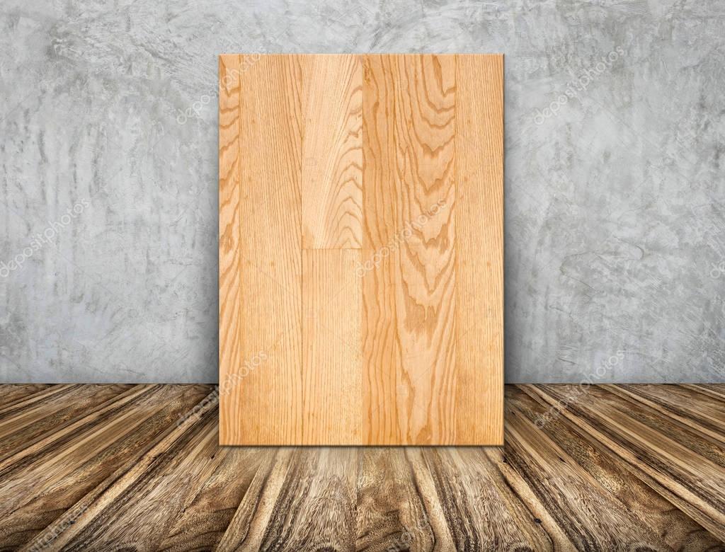En blanco marco de madera simple apoyado en el muro de for Hormigon encerado sobre suelo de baldosas